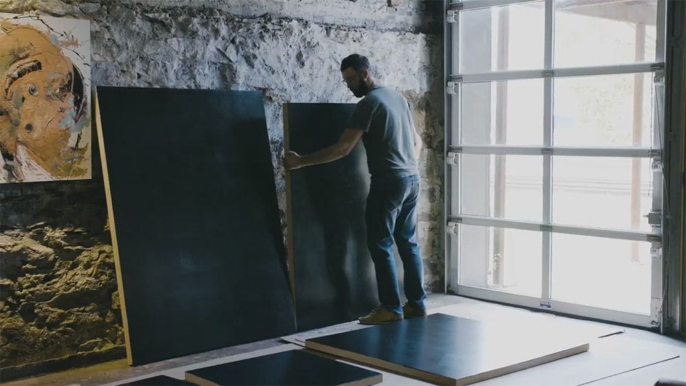 Daniel McClendon chooses a blank panel for a new painting
